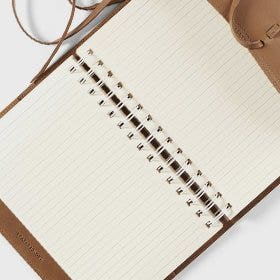 Shop refillable leather spiral journals!