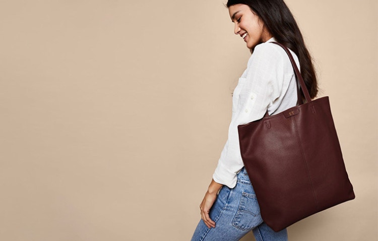 Try Our Uptown Vertical Tote in Bordeaux for a Classic Look