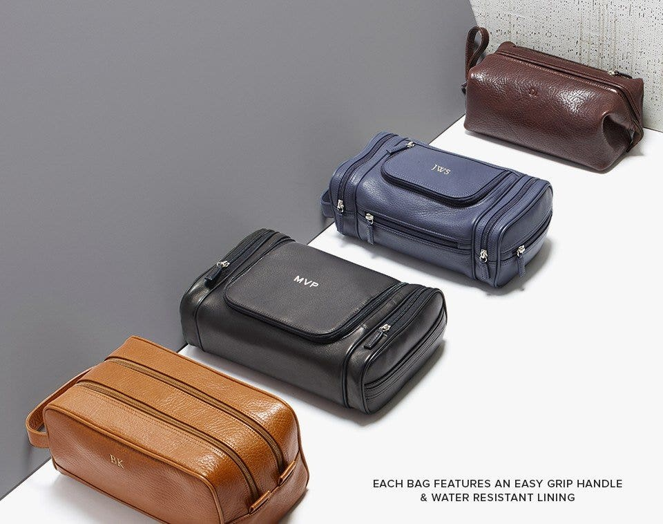 Leather toiletry bags with easy grip handle and water resistant lining
