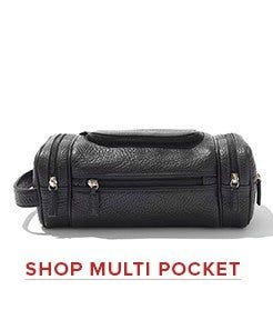 Toiletry dopp kit with multiple pockets for organized travel.Leather toiletry bags with easy grip handle and water resistant lining