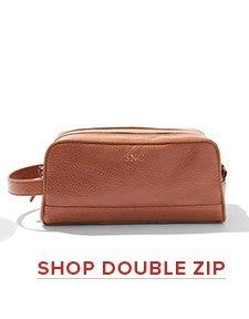 Double zippered compartments to divide toiletry from travel accessories.Leather toiletry bags with easy grip handle and water resistant lining